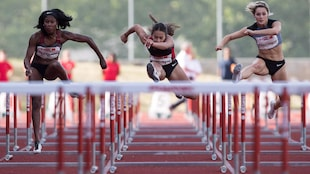 First-place finisher Farah Jacques, left, of Gatineau, Que., fourth-place finisher Katarina Vlahovic, of Surrey, B.C., and third-place finisher Georgia Ellenwood, right, of Langley, B.C., compete in the women's 100 metre hurdles during the Harry Jerome International Track Classic, in Burnaby, B.C., on Wednesday, June 27, 2018. THE CANADIAN PRESS/Darryl Dyck