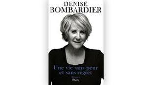 Denise Bombardier porte un veston noir.