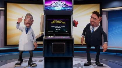 Edmond et Gérard sont à côté d'une machine qui ressemble à un vieux jeu d'arcade.