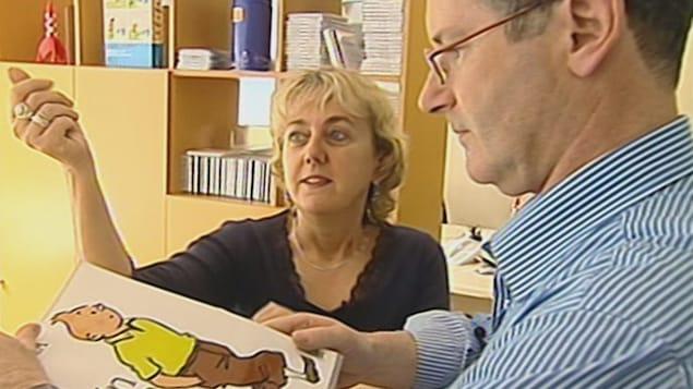 La graphiste Louise Cliche et le journaliste Luc Chartrand discute de Tintin.