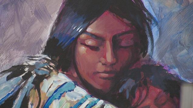 une peinture avec un visage de femme autochtone et son enfant dans les bras