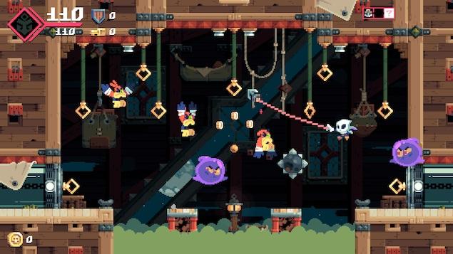 Le joueur lance son harpon sur un anneau pour ne pas tomber dans un nuage toxique qui se trouve au-dessous de lui.
