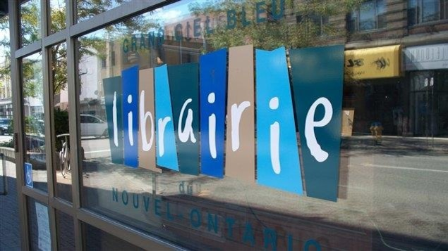 Pancarte de la librairie Grand ciel bleu.