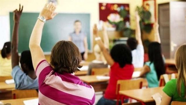 Des étudiants en salle de classe