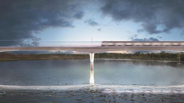 Une maquette du projet montrant un train passer au-dessus d'un cours d'eau.