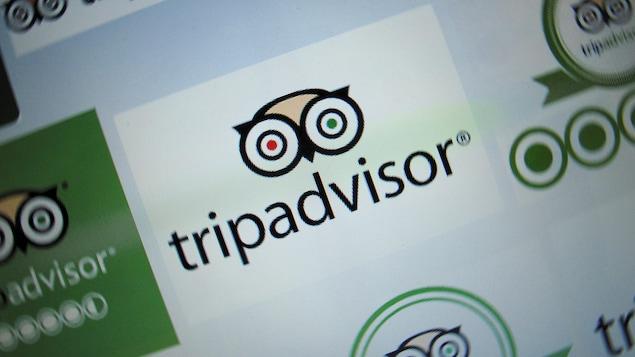 Le logo de TripAdvisor représentant les yeux d'une chouette s'affiche sur un écran d'ordinateur.