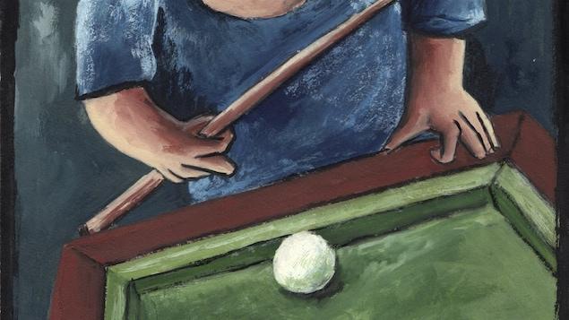 Un homme joue au billard