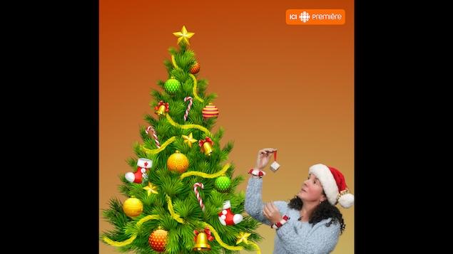 Eve Christian regarde une boule de Noël en chocolat devant un arbre de Noël
