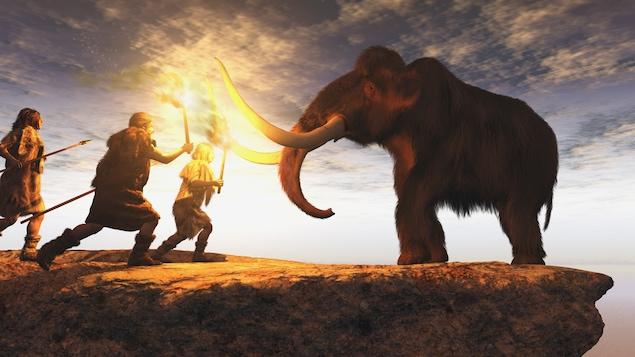 Des hommes préhistoriques chassent un mammouth