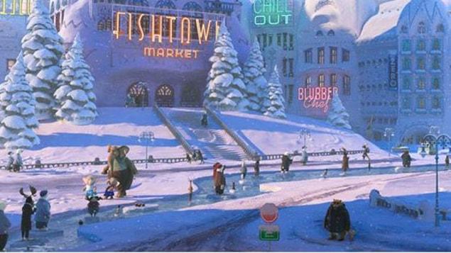 Une patinoire au milieu d'une ville enneigée.