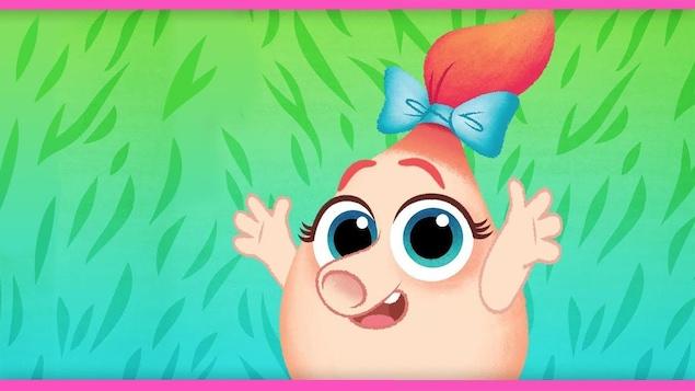 Une petite fille avec un noeud dans les cheveux et un grand sourire
