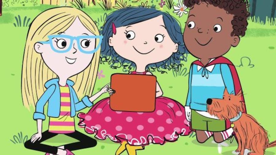 Ils sont assis dans l'herbe et jouent avec une tablette
